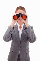 Bank employee looking through spyglasses against a white background