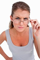 Portrait of a serious woman with glasses against a white background