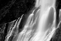 dramatic blurred view of waterfall flowing over rocks