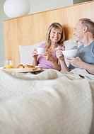 Senior couple enjoying breakfast in bed