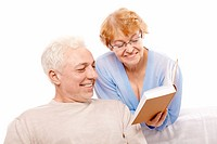 Older persons read the book on a white background