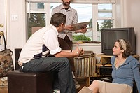 Men and Woman Sitting Around with Record Collection