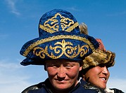 Kazakh men wearing traditional hats to their heads