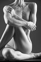 Nude female athlete in yoga pose