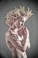 Blonde woman with flying curly hair topless