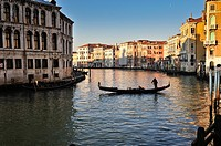 Grand Canal of Venice at sunset with gondola