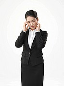 portrait of a young businesswomen rubbing her temples