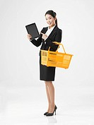 Full_length View of Business woman holding tablet PC
