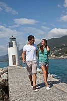 Couple walking by lighthouse