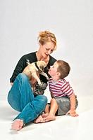 Kissing the new bamily pet Pug