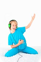 young teen kid playing air guitar and listening to
