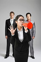 portrait of business woman holding megaphone with colleague, computer imaging
