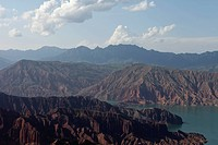 panoramic view of Liujiaxia Reservoir surrounded by mountain range, Linxia, Gansu, China, Asia