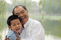 Grandfather and young boy laughing together