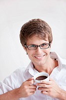 A young handsome man with a coffee