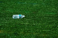Empty water bottle on grass