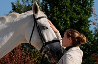 Woman and German Warmblood Horse, gelding