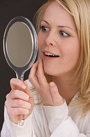woman look into the mirror