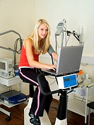 Young woman on a Ergometer in the surgery