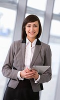 Portrait of smiling businesswoman holding digital tablet