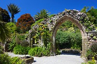 Old stone archway from the ruined abbey in the sub_tropical Abbey Gardens, Island of Tresco, Isles of Scilly, England, United Kingdom, Europe