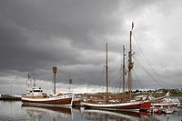 Traditional boats in the fishing port of Husavik, Husavik, Iceland