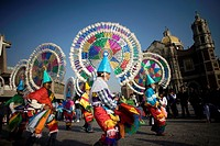 Dancers from Huehuetla, Puebla state, perform the Quetzal dance outside the Our Lady of Guadalupe Basilica in Mexico City, December 10, 2011  Hundreds...