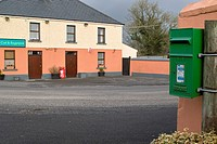 The Cat and Bagpipes Pub in Tubber village, Co. Offaly, Ireland, with postbox in foreground