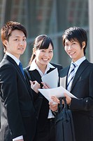 Young Businessmen and Businesswoman with Documents