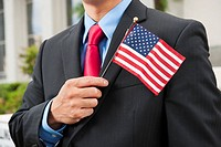 Chinese businessman holding American flag (thumbnail)