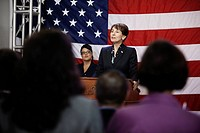 Female politician making speech at podium (thumbnail)
