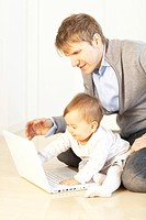 Father and Baby Girl Using Laptop