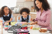 Mixed race mother preparing daughter´s lunch