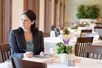Hispanic businesswoman working in restaurant