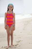 Caucasian girl standing on beach