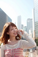 Young Woman On Phone in City