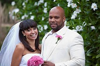 Smiling Black bride and groom on wedding day