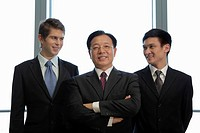 Three businessmen standing together