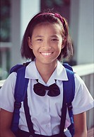 Portrait of a young Thai schoolgirl 11 yo in uniform