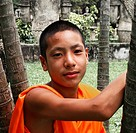 Portrait of a young buddhist monk in Xieng Khuan Buddha park