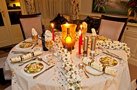 christmas dinner table setting at night