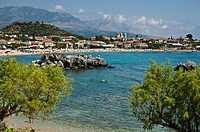 Stoupa seafront and beach with the Taygetos mountains in the background, Messinia, Outer Mani, Southern Peloponnese, Greece