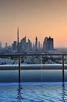Sunset on the Business Financial District from a rooftop pool  Dubai, United Arab Emirates