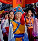 Paris, France, Street Scene, French-Chinese Female Teens in Traditional Costumes Parading in Chinese new years Carnival in Street in the Marais Area