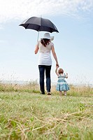 Woman with daughter and umbrella