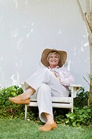 Older woman relaxing in backyard