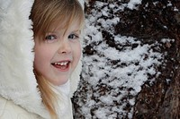 Smiling girl standing outdoors in snow