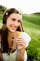Smiling woman wearing flower in her hair