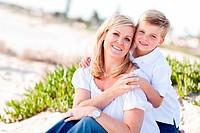 Cute Son Hugs His Mom at The Beach