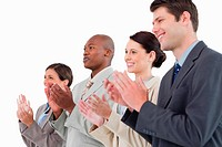 Side view of applauding businessteam standing together against a white background